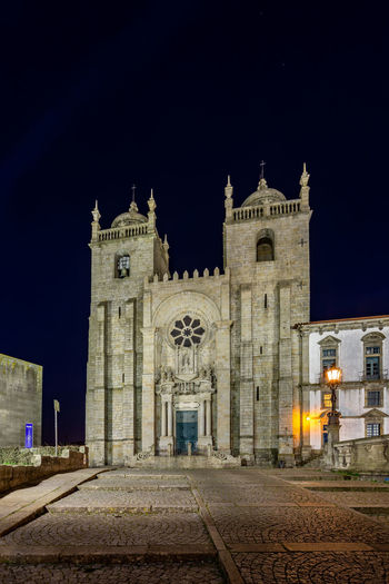 Sé do Porto (Cathedral) at Porto, Portugal Architecture Building Exterior Night Building History No People Place Of Worship The Past Travel Destinations Built Structure Illuminated City Religion Sky Spirituality Tower Outdoors Porto Portugal Europe Travel Tourism Tourist Attraction  Tourist Destination