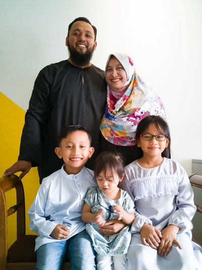 Portrait of happy family at home on eid-ul-fitr