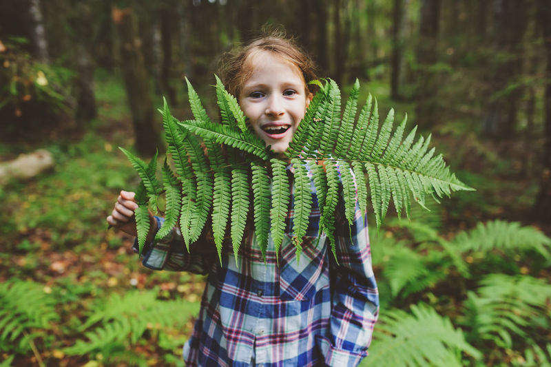 happy kid girl exploring summer forest, traveling on vacation. Teaching kids to love nature. Earth day concept. Plant Real People Nature Lifestyles Outdoors Summer Summertime Woods Forest WoodLand Explore Adventure Travel Wild Backpack Kid Childhood Girl Happy Authentic Moments My Best Photo