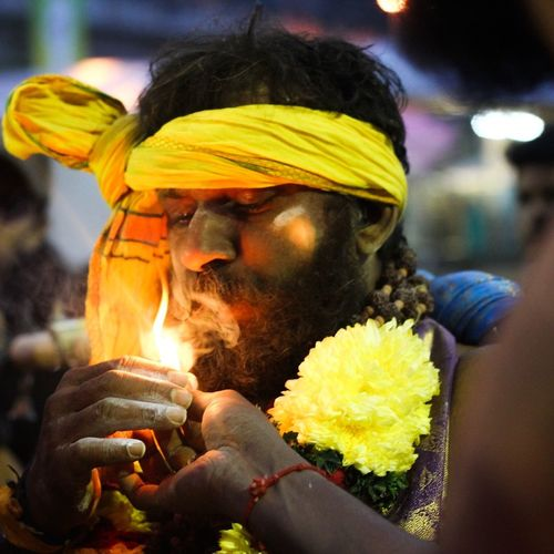 thaipusam fiestival at batu caves. Thaipusam Reportagesportlight Streetphotography pOtraitmood Lenscultureportraits Religion Spirituality Cultures Flower Yellow Focus On Foreground Floral Garland Close-up Real People Men Outdoors Sari Day Canon_photo