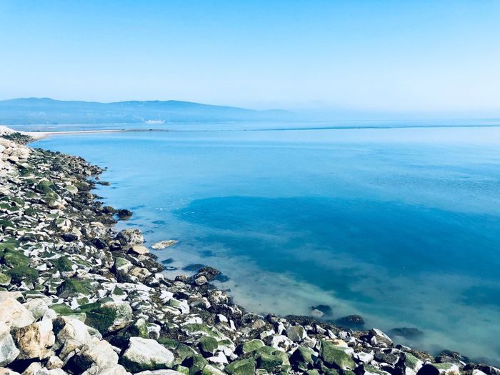 Water Sea Beauty In Nature Scenics - Nature Tranquility Sky Tranquil Scene Non-urban Scene Rock - Object Rocky Coastline Outdoors Day Idyllic Horizon Over Water Rock No People Beach Land Blue Nature