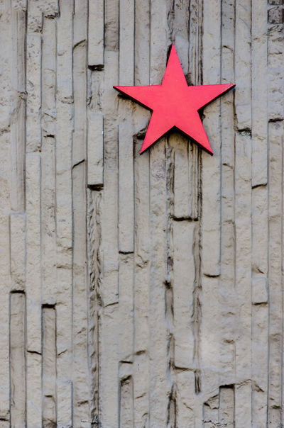 Christmas Christmas Decoration Concrete Wall Day No People Outdoors Pattern Red Star Rough Texture Rough Texture. Star Structure Surface Texture