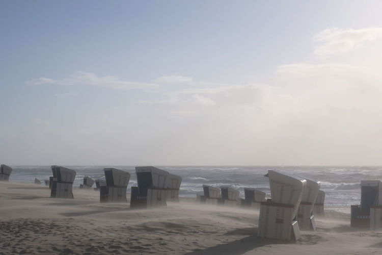 Sky Sea Land Beach Water Cloud - Sky Scenics - Nature Tranquility Tranquil Scene Nature Horizon Beauty In Nature Horizon Over Water Sand No People Day Outdoors Chair Absence Sandstorm Sylt Beachchairs Beachchair Nordsee