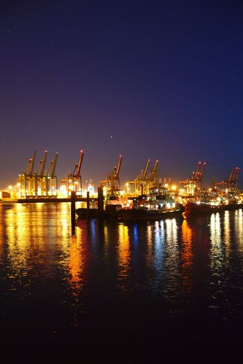 Nature River Elbe ♥️ Light And Shadow Night Lights Night Photography Night Life Night Shot Night City Beauty In Nature Sunshine Outdoors Shipyard Water Nautical Vessel City Illuminated Harbor Industry Sea Cargo Container Commercial Dock Industrial District Ship Crane - Construction Machinery Shipping  Loading Unloading Nautical Equipment