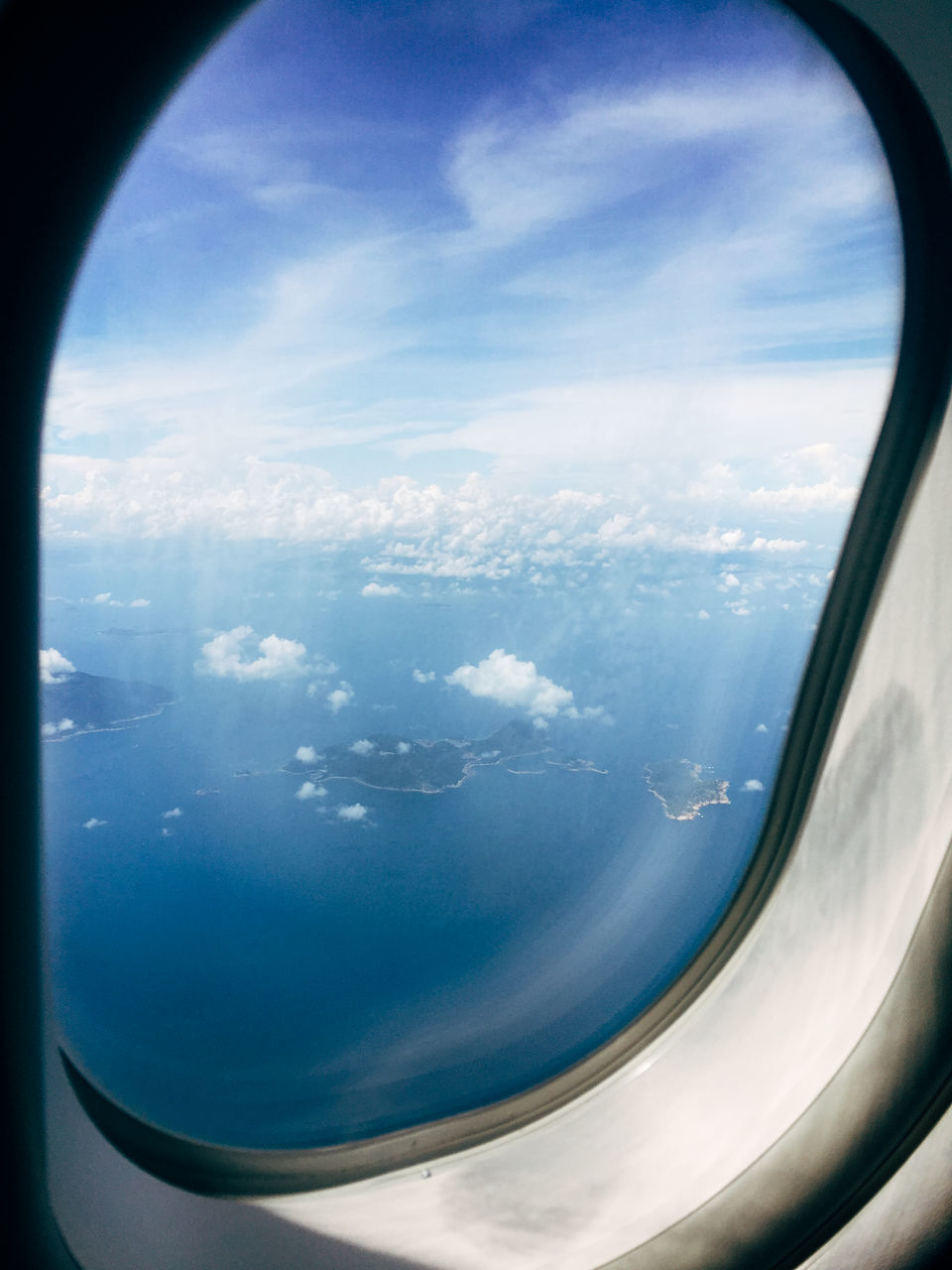 sky, airplane, cloud - sky, beauty in nature, journey, transportation, travel, no people, nature, window, day, blue, sea, airplane wing, scenics, landscape, outdoors, vehicle part, air vehicle, close-up