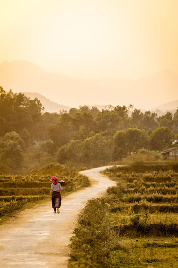 The Long Way Home ASIA Asian  Country Road Countryside Dusk Hard Day Hmong Lifestyles Mountain Nature On The Move Outdoors Road Sky Sunset The Way Forward Traditional Tranquil Scene Vietnam Vietnamese Walking Lost In The Landscape