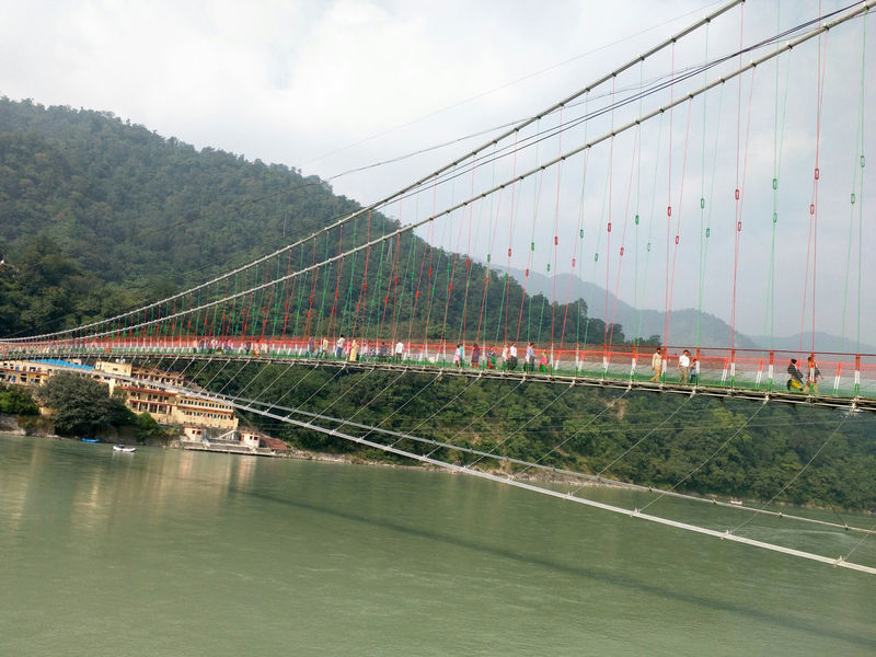 Sky Bridge - Man Made Structure Tree Cloud - Sky Water Transportation Connection Outdoors No People Travel Destinations Built Structure River Architecture Mountain Suspension Bridge Rishikesh Haridwar LaxmanJhula Hanging Bridge Ganga Uttarakhand Vacations Nature Holiday Finding New Frontiers