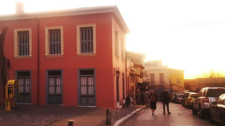 Sunset Sunlight Streetphotography Streets Streetsofathens Athens City Athensstreetphotography Building Exterior Architecture Built Structure Sunlight Outdoors Day City Red People Sky Walking Lifestyles