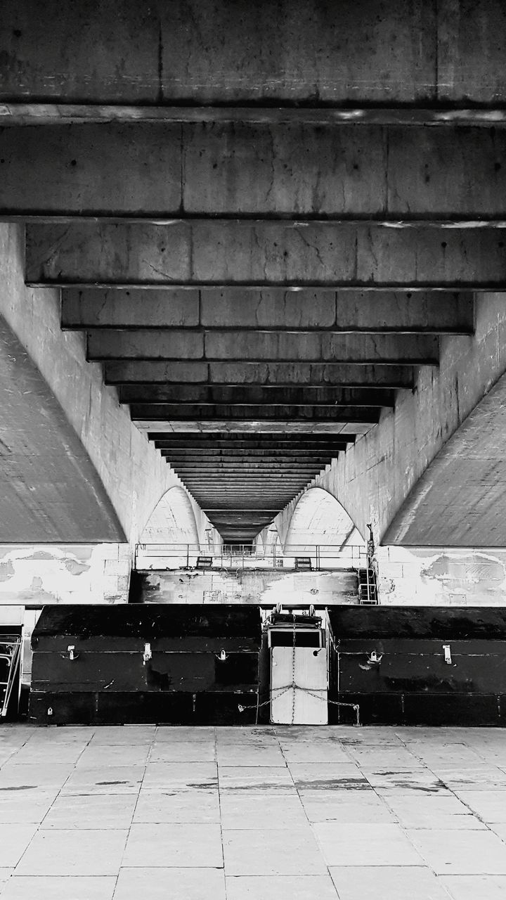 architecture, built structure, transportation, no people, connection, bridge, day, indoors, bridge - man made structure, direction, the way forward, architectural column, in a row, ceiling, public transportation, travel, city, subway, underneath, parking garage