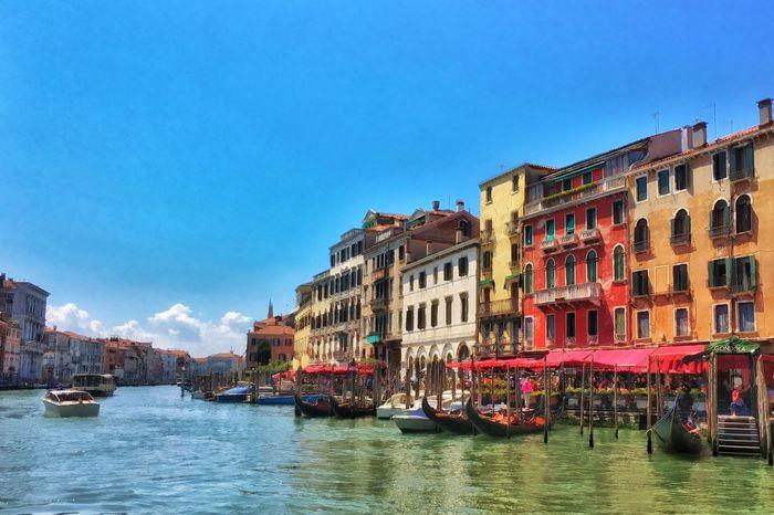 Murano island near Venice. Canal traffic in front of beautiful colorful buildings Murano Island