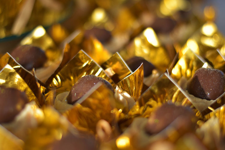 Abundance Backgrounds Chocolate Chocolates Close Up Close-up Food Delicious Edible  Gold Gold Colored Gold Package Indoors  No People Party Time Selective Focus Sweet Food Sweet Tooth