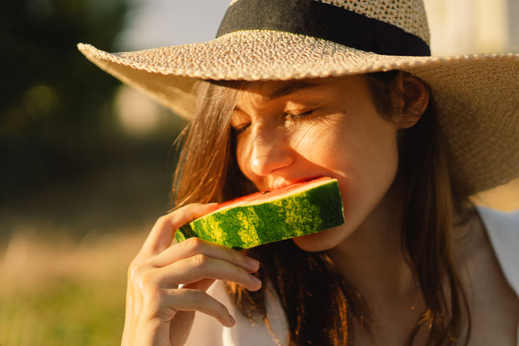 Close-up of woman eating watermelon
