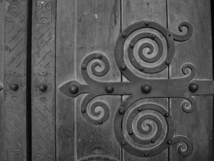 Backgrounds Blackandwhite Close-up Day Door Full Frame Gyre Medieval Metal No People Outdoors Pattern Spire  Wood - Material Wrought Iron