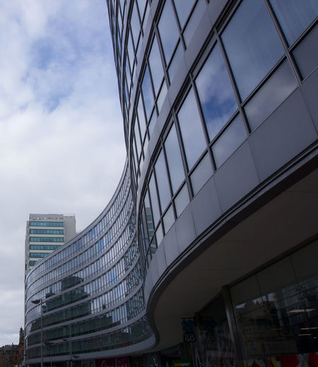 Reflection of clouds in curved glass building at Manchester Piccadilly Manchester Picadilly Station Architecture Building Exterior Built Structure City Sky Modern Building Office Building Exterior Cloud - Sky Office Glass - Material Low Angle View No People Nature Skyscraper Outdoors Day Tall - High Reflection Construction Industry Location Place