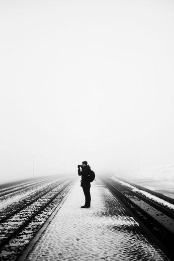 Man On Snowy Field Against Clear Sky