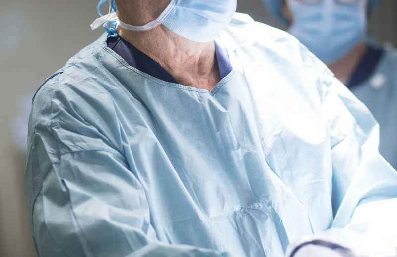 Midsection of surgeons in operating room