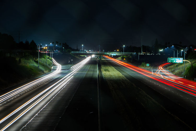 Blurred Motion City City Life Diminishing Perspective Glowing Highway Illuminated Light Trail Long Exposure Motion Multi Colored Night No People Outdoors Road Sky The Way Forward Traffic Vanishing Point