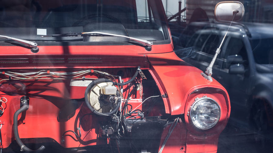 Auto Repair Shop Automobile Industry Car City Close-up Damaged Day Engine Focus On Foreground Indoors  Industry Land Vehicle Mode Of Transportation Motor Vehicle No People Red Ruined Shopping Stationary Transportation