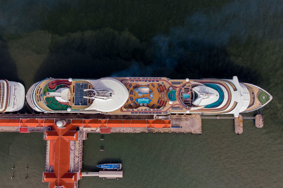Bird Eyes View of a giant cruise ship Interior Bird Eyes View Cruise Ship Exterior Georgetown Penang Holiday Pier Aerial View Amusement Park Architecture Blue Cloud - Sky Day Directly Above Interior Jetty Mode Of Transportation Multi Colored Outdoors Reflection Tourism Transportation Water