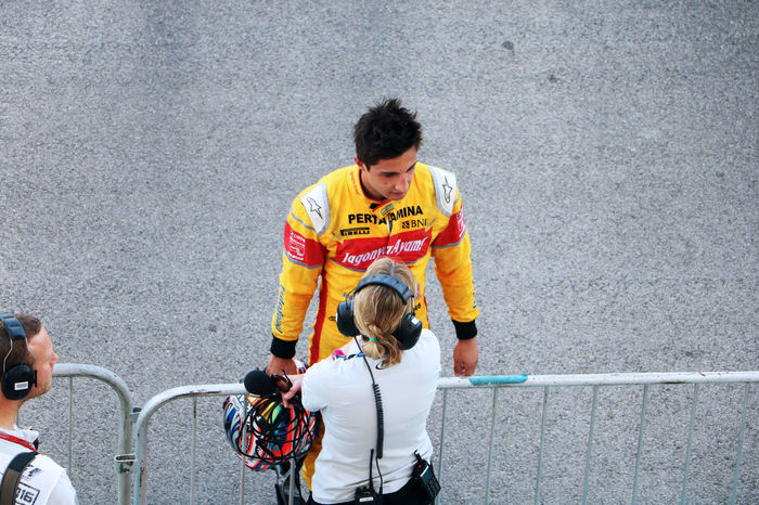 Competitive Sport Day Fence Helmet Interview Journalists Motorsport Outdoors People Yellow Young Adult