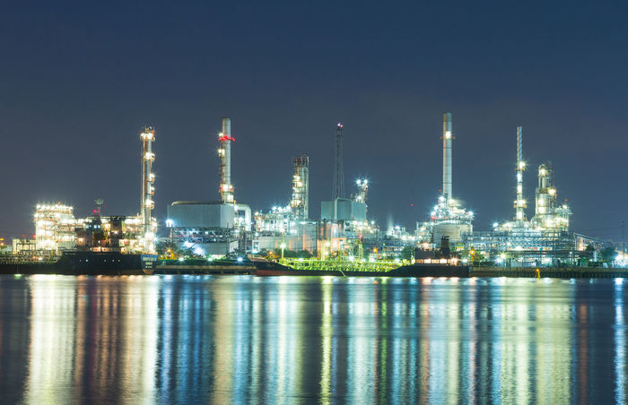 Building Exterior Built Structure Distillation Factory Fuel And Power Generation Gasoline Illuminated Industry Night No People Oil Industry Oil Refinery Outdoors Petrochemical Plant Refinery Reflection Sea Sky Smoke Stack Water