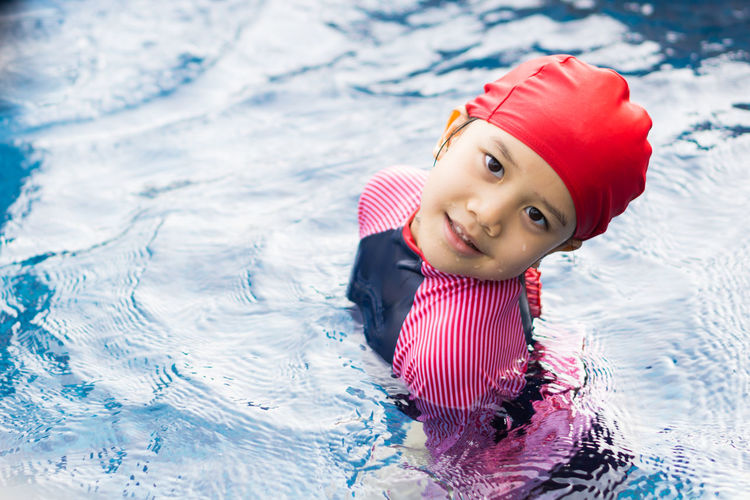 Portrait of cute girl in swimming pool