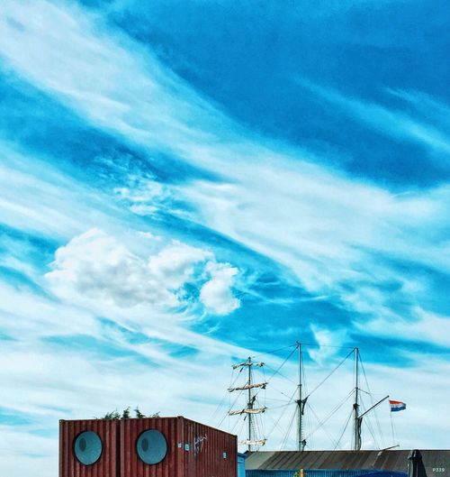 The Stare. P339 Low Angle View Blue Cloud - Sky Sky Development Connection High Section Cloud Day Outdoors Nature Cloudscape No People Progress Shipping Containers Three Masts Ship Dutch Flag IPhone Editing Onephotoaday Beauty In Nature Tranquility