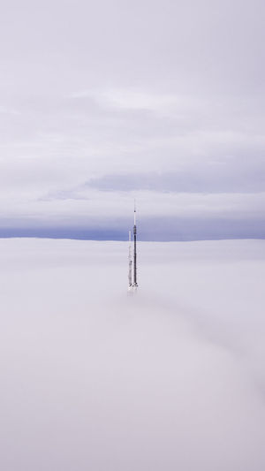 Just the TIP Sky Tower Cloud - Sky No People Nature Direction Tall - High Day Guidance Architecture Travel Built Structure Water Outdoors Tranquility Beauty In Nature Fog Tranquil Scene Scenics - Nature Sailboat