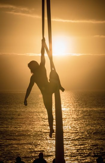 Sunset paradise Sunset Water Sky Sea Silhouette Real People Horizon Over Water Orange Color Horizon Nature Leisure Activity Lifestyles Waterfront Sunlight Full Length One Person Outdoors Beauty In Nature Scenics - Nature Sun