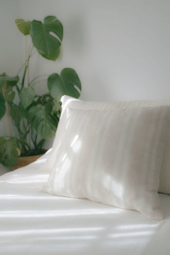 Close-up of white bed at home