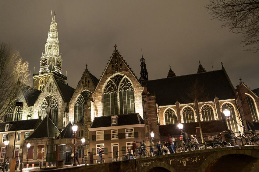 The Oude Kerk, Amsterdam, Netherlands Amsterdam Netherlands Architecture Belief Building Building Exterior Built Structure City Gothic Style History Illuminated Night Oude Kerk Outdoors Place Of Worship Religion Sky Spire  Spirituality Tourism Tower Travel Travel Destinations