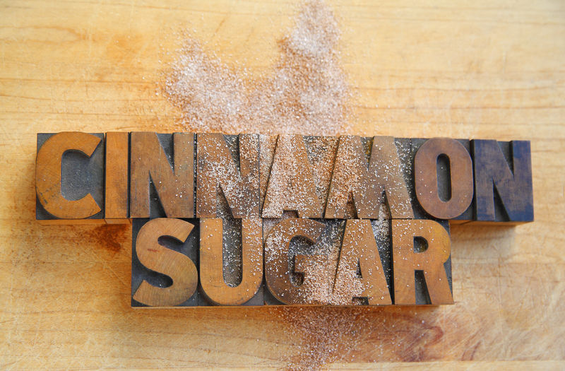 Cinnamon sugar words on cutting board Copy Space Ingredients Natural Light Textures Typography Cinnamon Sugar Close-up Communication Day Flavoring Font Food Indoors  No People Overhead Room For Text Spice Studio Shot Sweet Text Wood - Material Woody Type Words