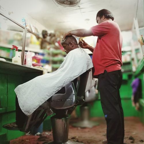 Road side Barber Hair cut Hairdresser Hairstyle Haircut Hair Salon Hairfashion Hair Care Hair Color Hairstylist Road Side Shop Roadside Roadsidephotography Roadside Shots Hairstyle Happiness Smiling Business Finance And Industry Spraying Cutting Hair Barber Shop Barber EyeEmNewHere