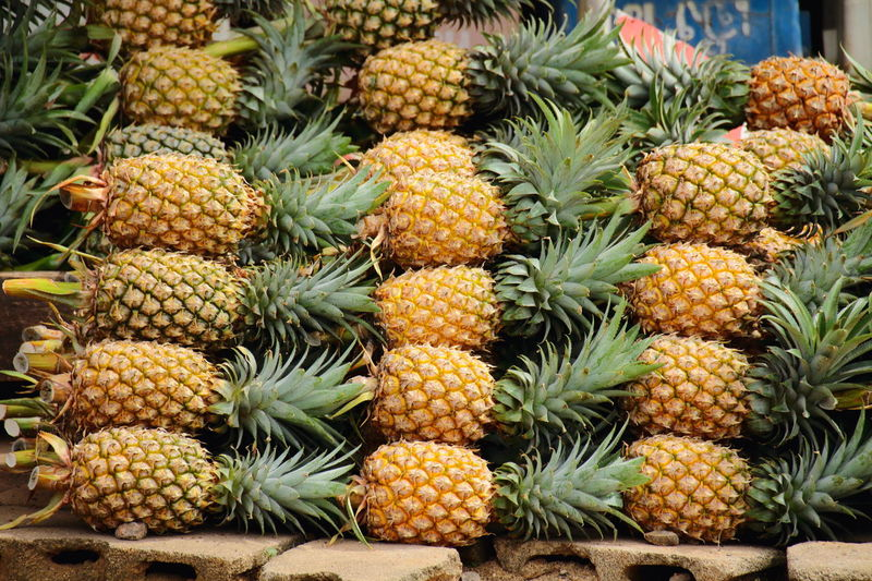 Day Outdoors Market Food And Drink No People Food Freshness Full Frame Fruit Healthy Eating Beauty In Nature Growth Nature Photography Green Color Freshness Close-up Plant Focus On Foreground Backgrounds Pineapple Thailand Photos Thai Fruits