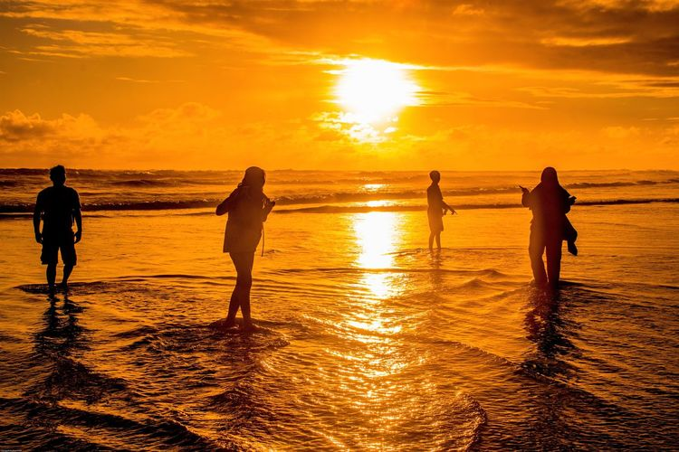 Friendship Sunset Sky Orange Color Silhouette Water Sea Real People Beauty In Nature Land Beach Group Of People Lifestyles Leisure Activity Reflection Togetherness Scenics - Nature Nature Cloud - Sky Men Horizon Over Water Sun Outdoors