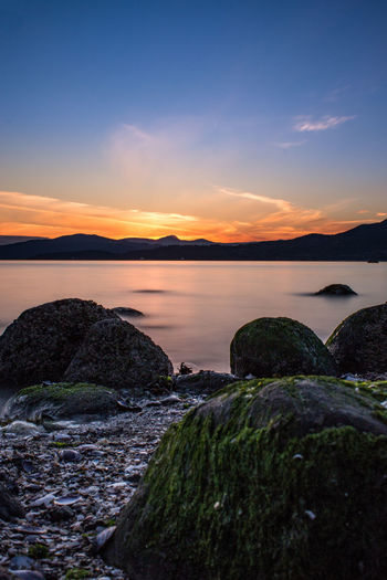 Third Beach in Vancouver, BC, Canada. View from Stanley Park Sky Sunset Water Beauty In Nature Scenics - Nature Rock Tranquility Tranquil Scene Solid Rock - Object Nature Idyllic Cloud - Sky No People Non-urban Scene Sun Sundown Orange Color Red Blue Ocean View Quiet Beautiful Rocks Long Exposure Vancouver Bc British Columbia Canada Beach Sand Mussel Shell Clouds Dramatic Sky Landscape Scenery Scenic Peaceful darkness and light Blue Hour Third Beach Stanley Park, Vancouver