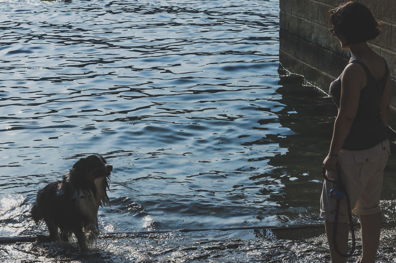 Young Woman With Dog In Lake