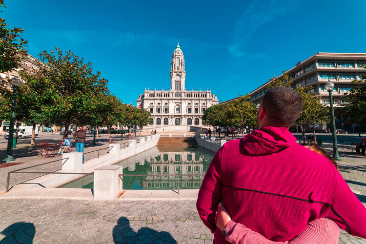 Couple Love Trip Portugal Square Monument Water Architecture Built Structure Building Exterior Rear View Real People Nature Day Sky Building Lifestyles City Men Tree One Person Travel Destinations Incidental People Adult Women Sunlight Outdoors Warm Clothing