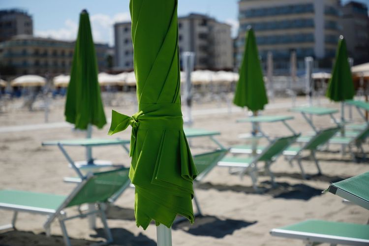 Travel Destinations Travel Traveling Detail Summer Sunshine Summer Views Parasol Parasols Green In A Row Italy Milano Marittima Adriatic Sea Adria Adriatic Beach Beachphotography Beach Life Sand Selective Focus Beautiful Still Life Nature Green Color Day Focus On Foreground Outdoors Sunbeds