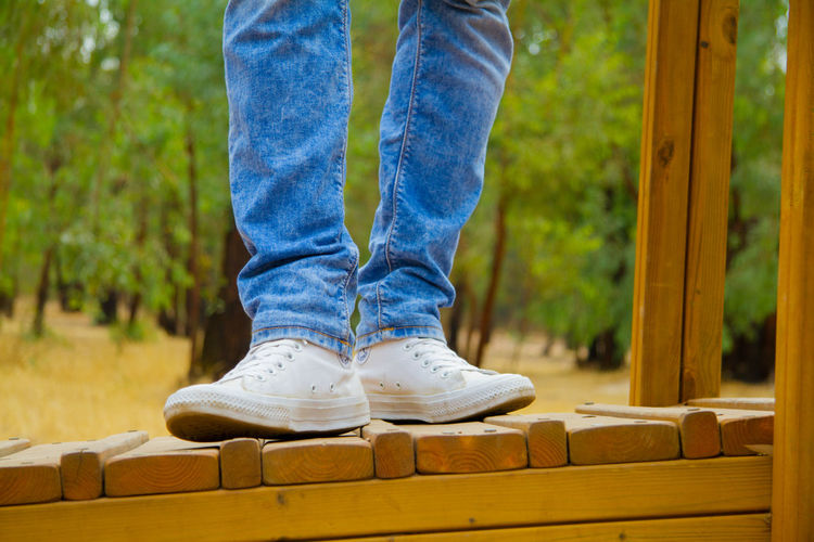 Blue Body Part Casual Clothing Day Denim Human Body Part Human Foot Human Leg Human Limb Jeans Leisure Activity Limb Low Section Men One Person Outdoors Relaxation Shoe Standing Teenager