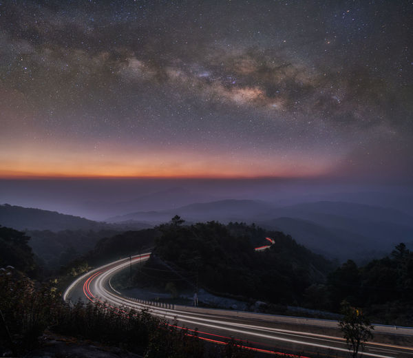 Beautiful sunrise and starry night with milk way at point of view of Inthanon mountain in Chiang mai,Thailand Astrology Chiang Mai | Thailand City Doi Inthanon Galaxy Inthanon Landscape Light Trail Milky Way Mountain Night Outdoors Sky Space Space And Astronomy Star - Space Starry Night Sunrise Thailanf Travel Destinations Tree