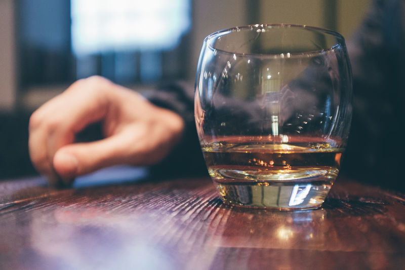 Alcohol Close-up Day Drink Drinking Glass Food And Drink Freshness Human Body Part Human Hand Indoors  One Person People Real People Refreshment Selective Focus Shot Glass Table Whiskey
