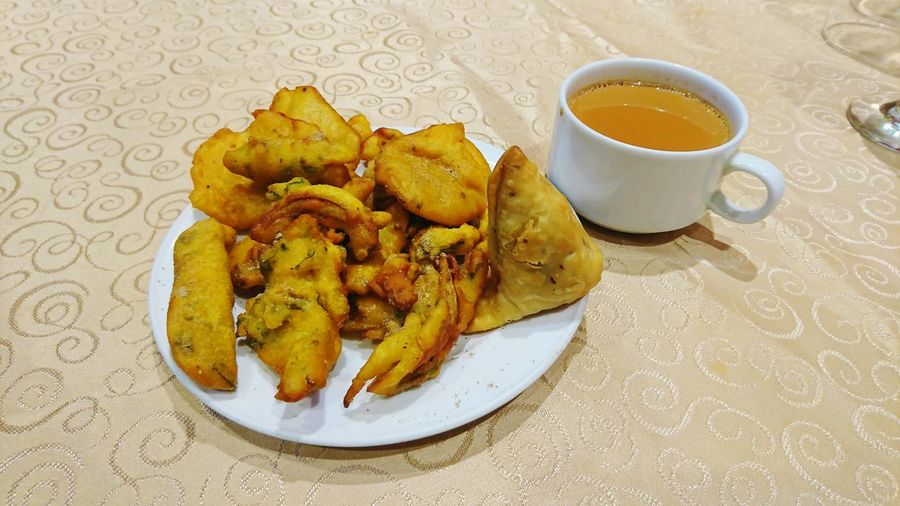Pakoda, Samosa and tea Samosa Pakoda Tea Indian Tea Food And Drink Plate Food Indoors  Coffee - Drink No People Freshness Ready-to-eat Close-up Day