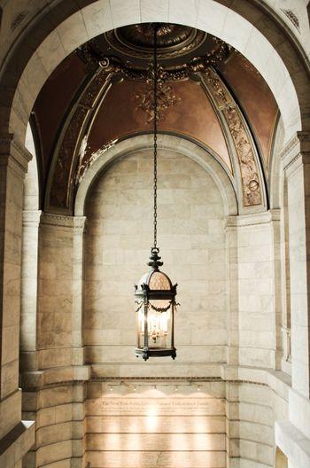 Old-fashioned illuminated lantern hanging at new york public library