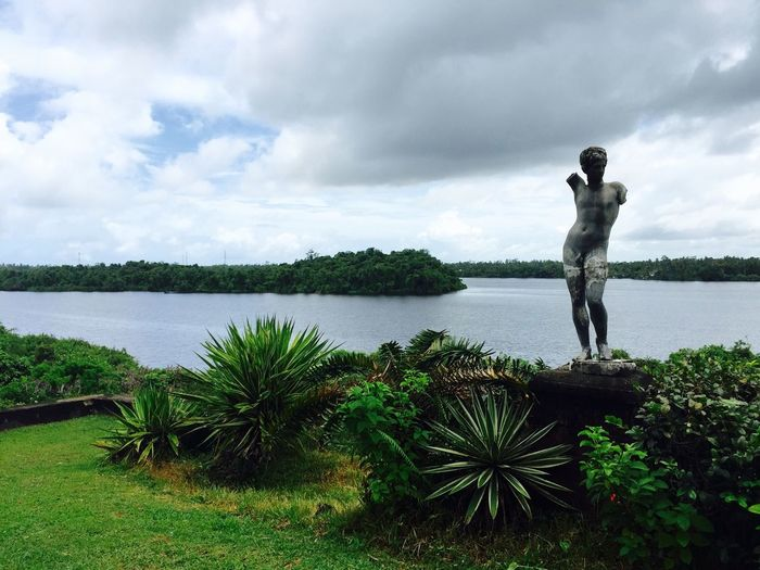 View Of Statue Against Calm Lake