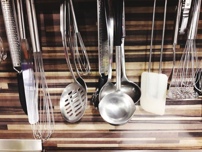 Close-up of kitchen utensils hanging on wall