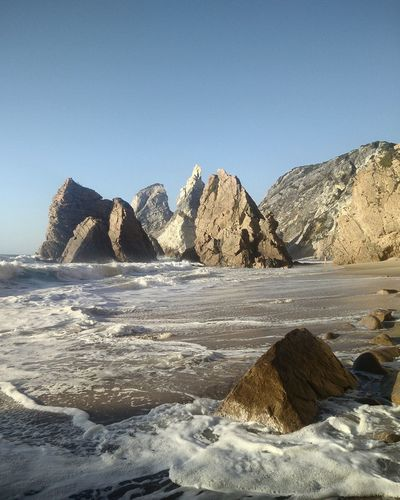 Scenic view of rock formations on beach