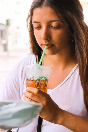 EyeEm Selects Drinking Straw Straw Drink One Person Refreshment Food And Drink Holding Women Front View Drinking Young Adult Young Women Adult Drinking Glass Long Hair Lifestyles Hairstyle Glass Beautiful Woman Hair