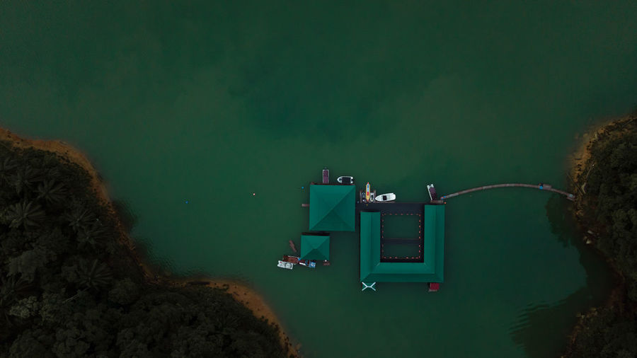High angle view of illuminated lights by sea