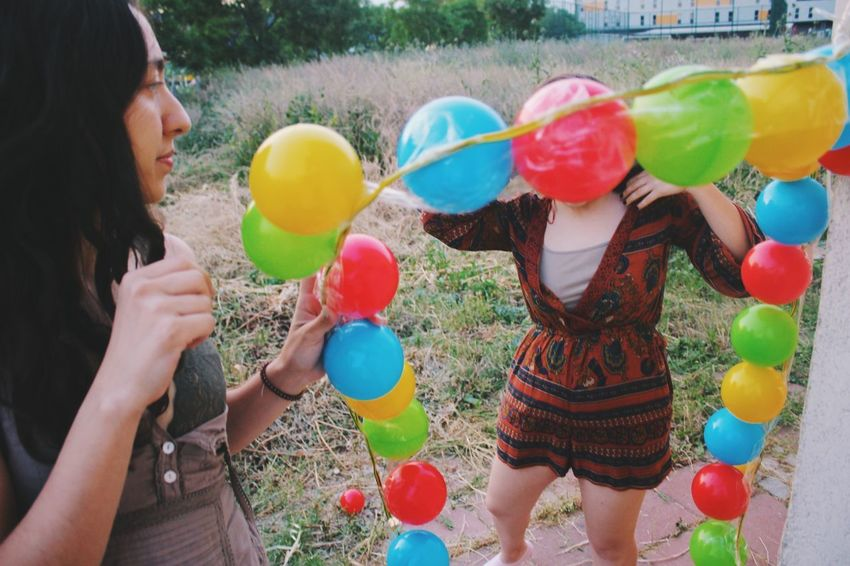 Ball Multi Colored Balloon Holding Leisure Activity Women Real People Day Togetherness Fun